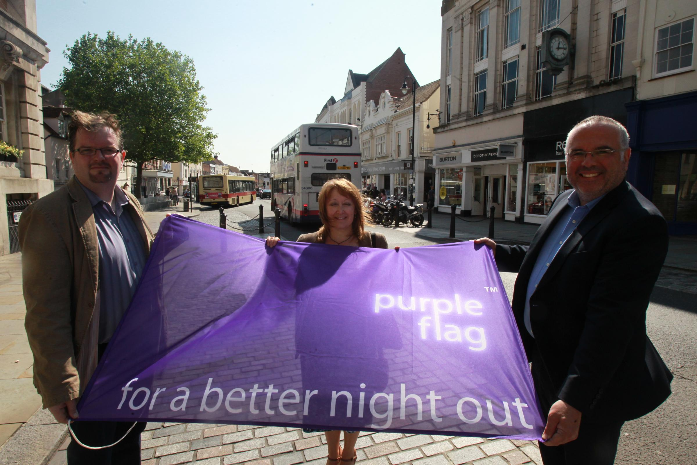 nigel brown.Nick Barlow and Tim Young receiving the Purple Flag award for offering a safe(!) nightlife in Colchester, on Monday at Colchester Town Hall.Also pictured is Karen Turnbull,Co-Ordinator......