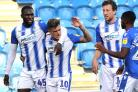 Team work - Sammie Szmodics (second from left) celebrates his opener for Colchester United against Crawley Town Picture: STEVE BRADING