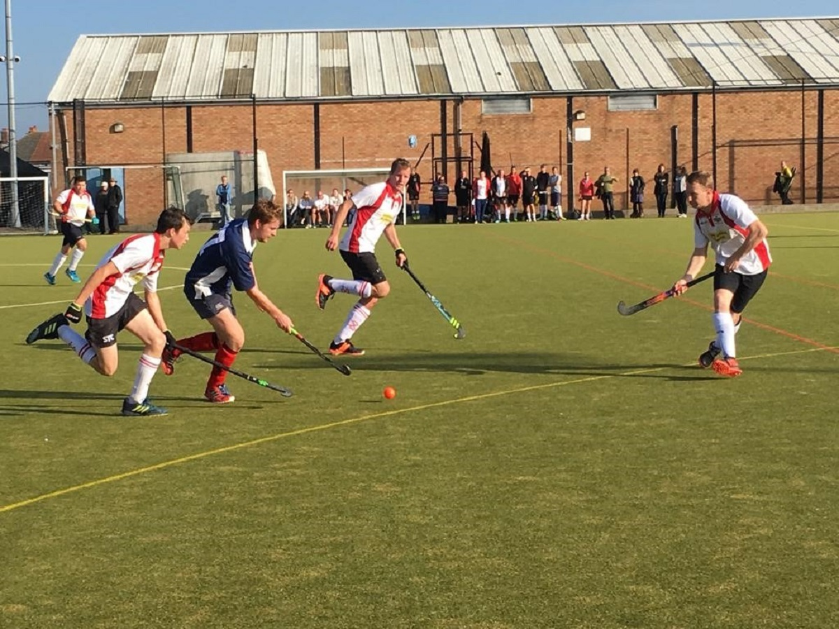 Tussle - action from Colchester Hockey Club's (white and red shirts) game at Felixstowe