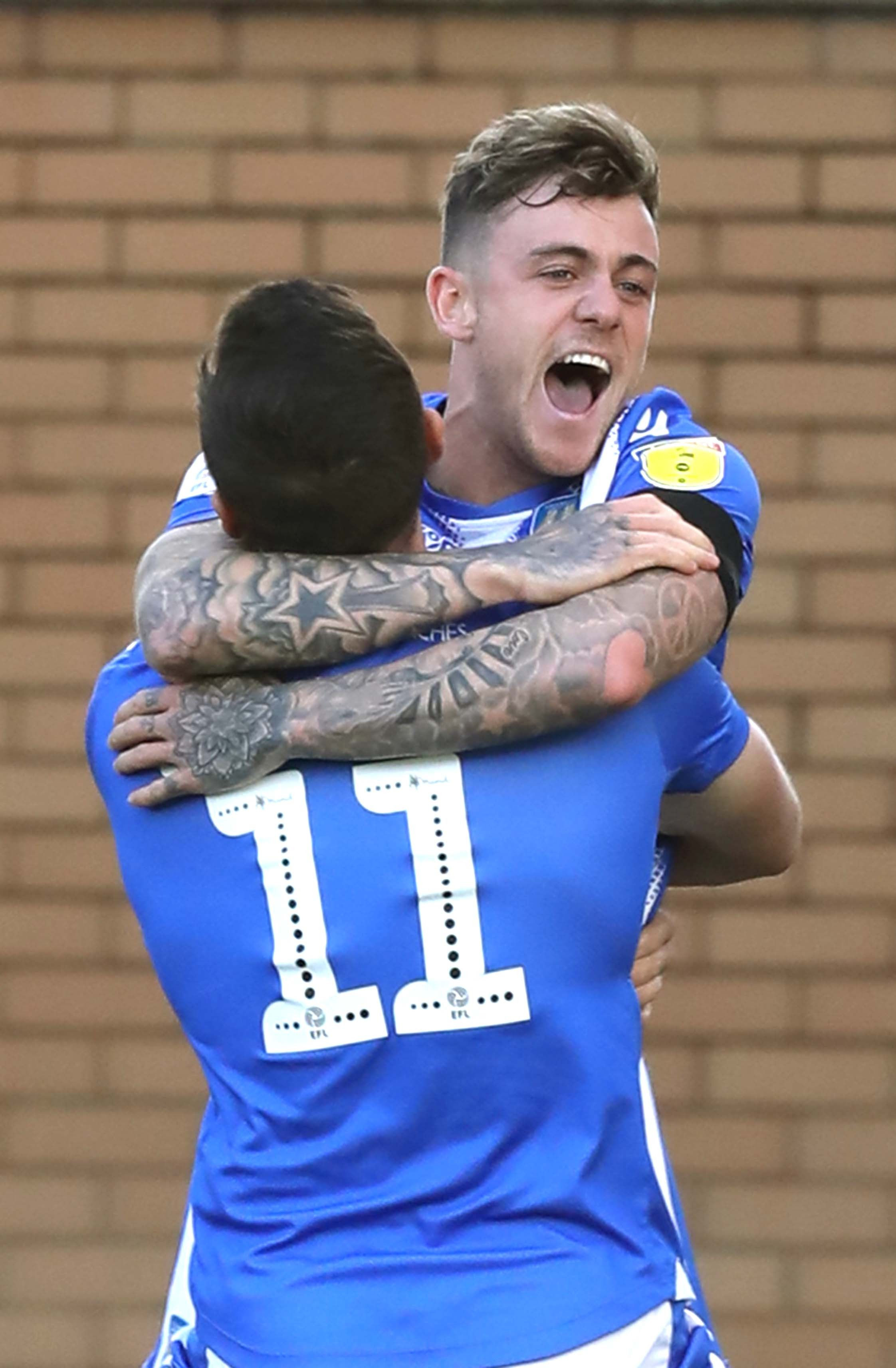 All smiles - Colchester United attacker Sammie Szmodics celebrates his goal with team-mate Brennan Dickenson Picture: STEVE BRADING