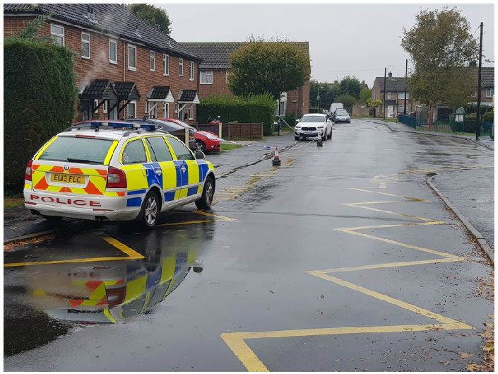 Scene - police at the scene of the stabbing in Madeville Road, Marks Tey.