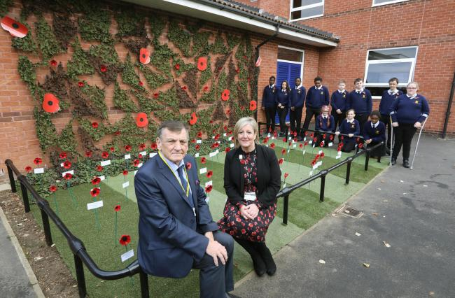 Thomas Lord Audley School WW1 Poppy tribute.Cllr Dave Harris representing the RBL with Head of Yr 11 Lorraine Robertson.