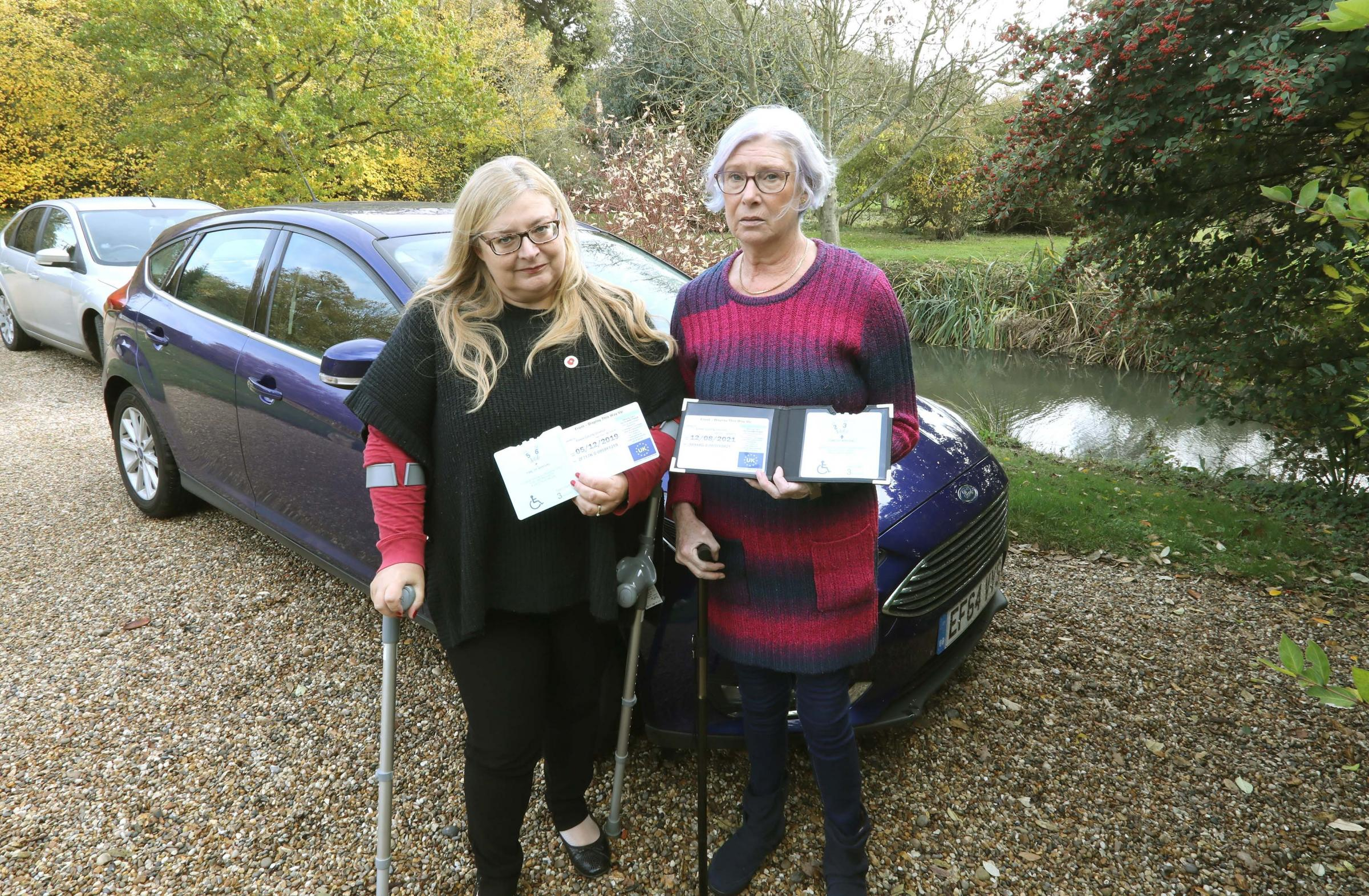 Angry - (from left) disabled drivers Celia Crossley and Annemarie O'Callaghan, unhappy with the lack of disabled parking in Colchester