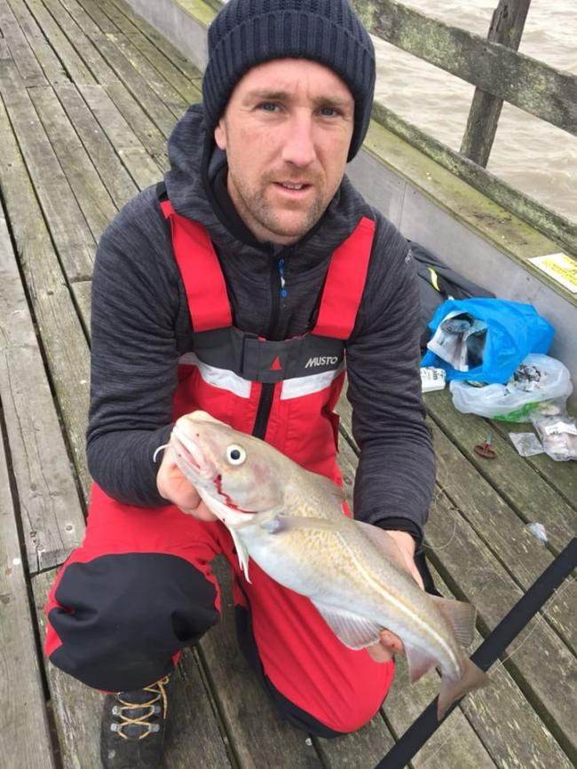 Great start: Daniel Tulip with a fresh run codling, caught from Walton Pier on his first cast of the day.