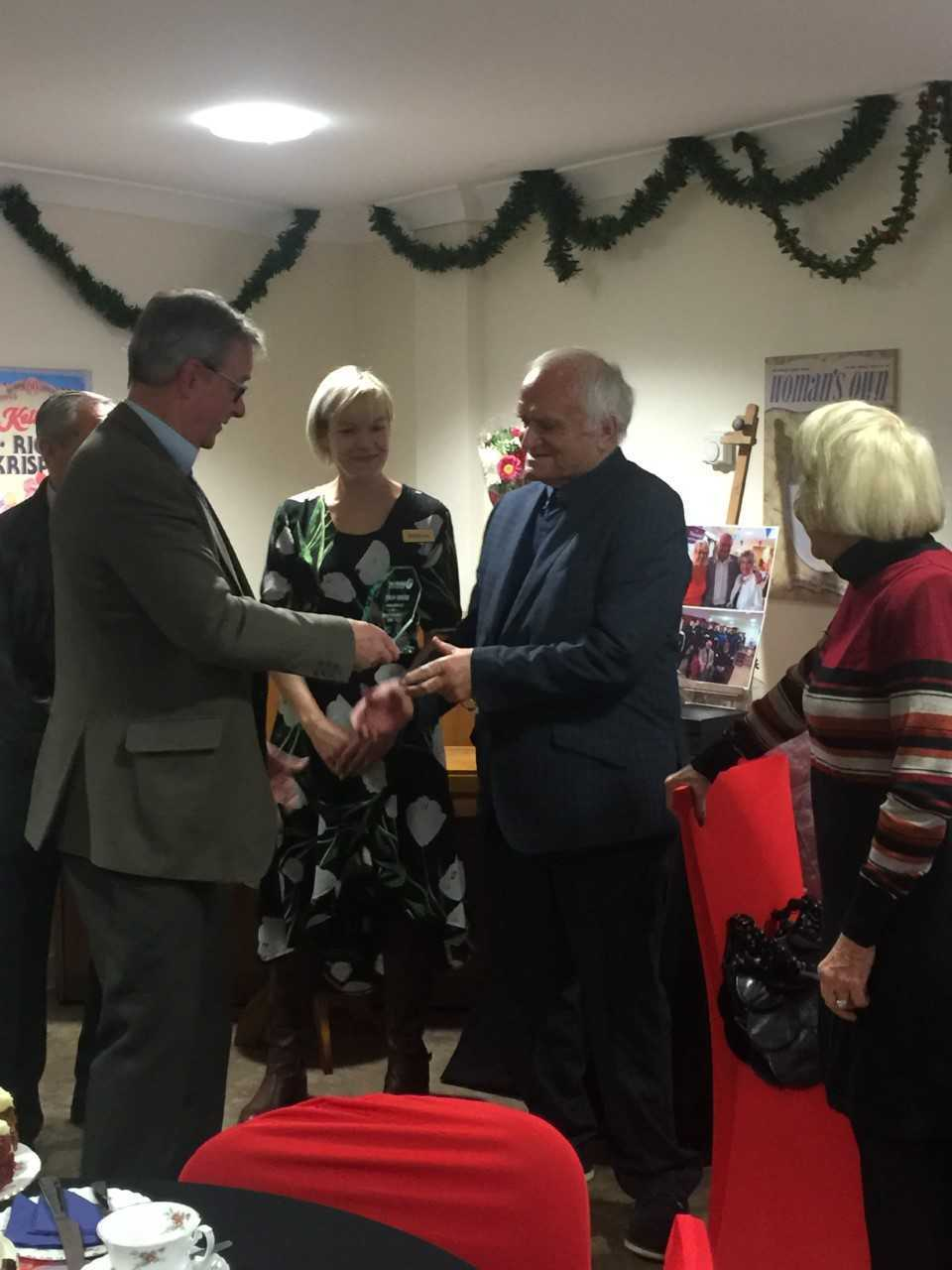Ambassador - Bobby Hunt receiving his trophy from staff at Foxburrow Grange