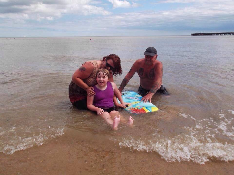 Family - Cheryl Darnell with husband Rick and daughter Ellie at Walton beach
