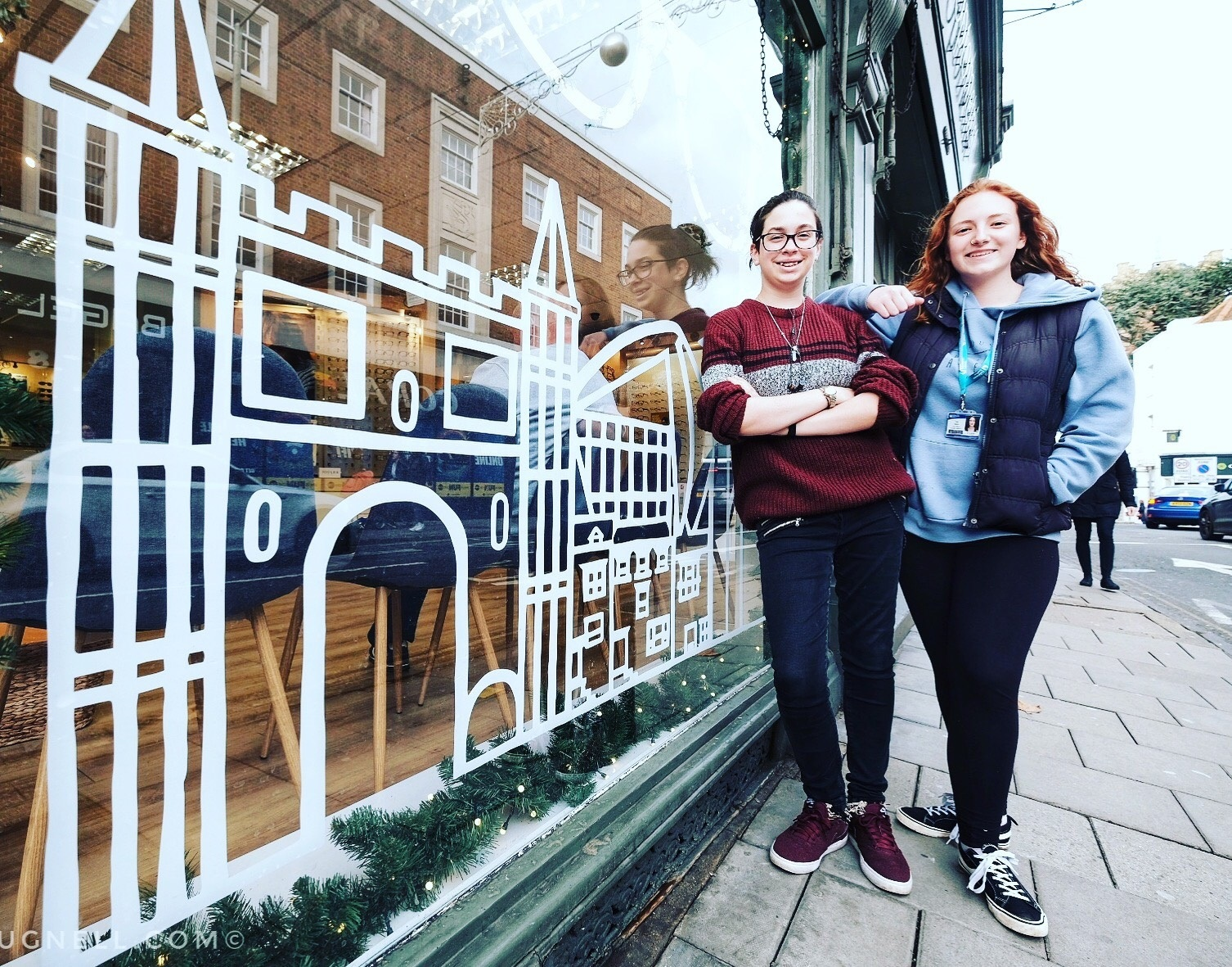 Rebecca and Talia with the window at Bethell and Clark in Head Street. PIcture by Nick Strugnell