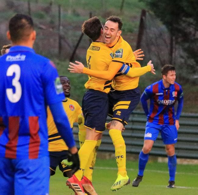 Sam Ashford celebrates scoring what proved to be the winning goal in Witham's 1-0 triumph at Maldon & Tiptree. Picture: Jim Purtill