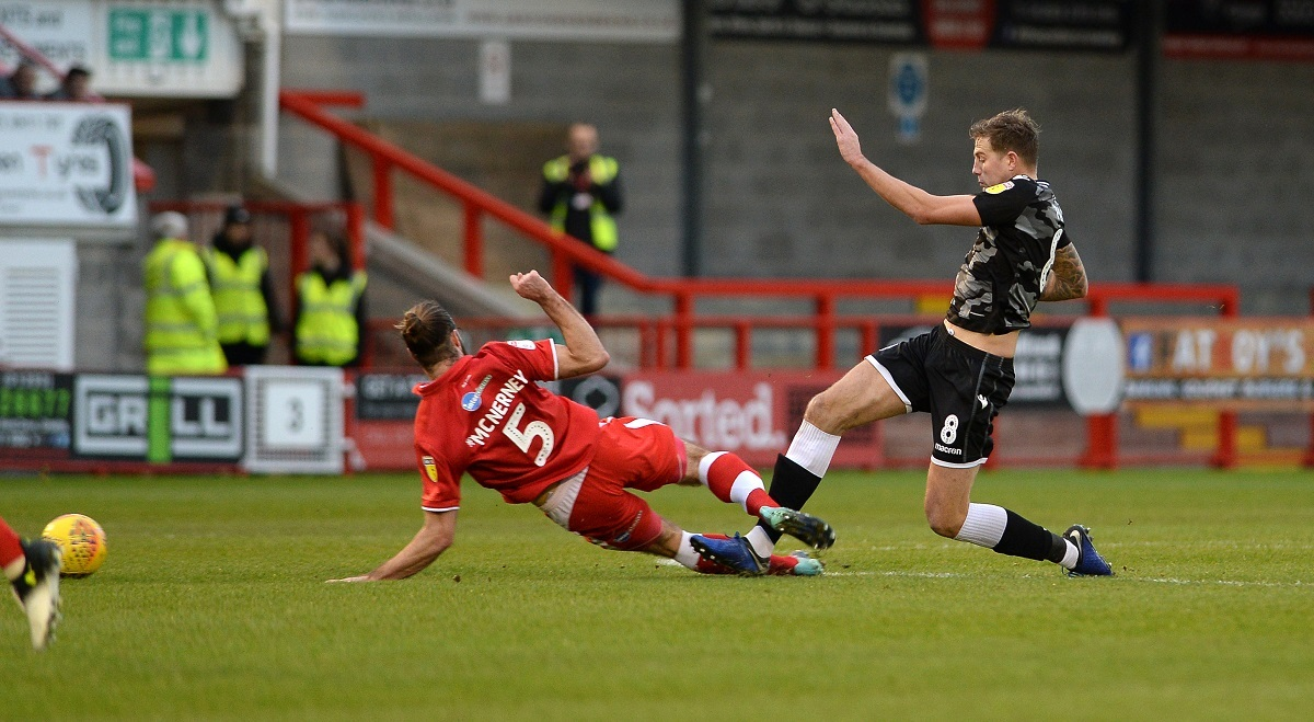 Flashpoint - Harry Pell falls victim to Joe McNerney's challenge which earned the Crawley Town defender a straight red card Picture: PAGEPIX