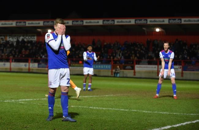 Freddie Sears covers his face after missing a gilt-edged chance in Town's FA Cup defeat at Accrington Stanley Picture: Pagepix