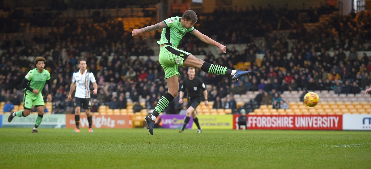 On target - Harry Pell volleys Colchester United 2-0 ahead at Port Vale Picture: PAGEPIX