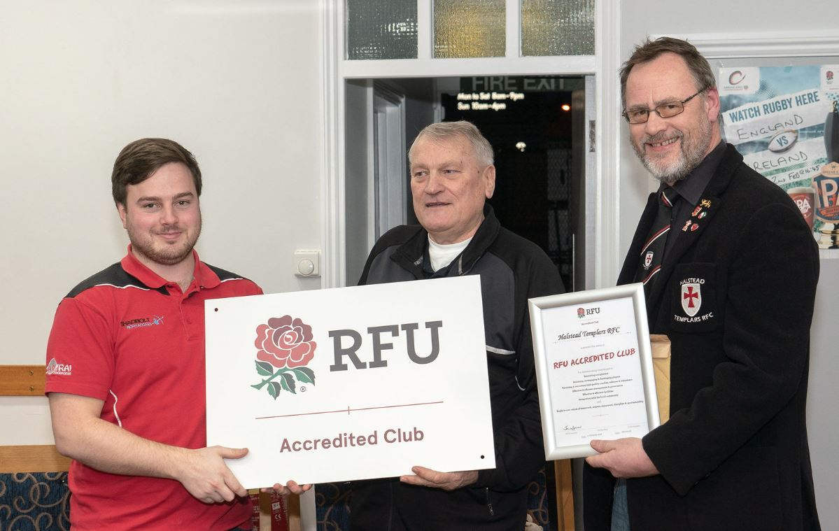 Halstead Templars' Liam Surgett (left) and president Rhys Vaughan Williams (right) receives the RFU Club Accreditation award from Essex RFU president Ivor Smith. Picture: Roger Cuthbert LRPS