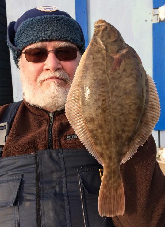 Prize-winning catch: Colchester Sea Angling Club member Bill Paqutte with his winning flounder, caught during the match at Holland-on-Sea.