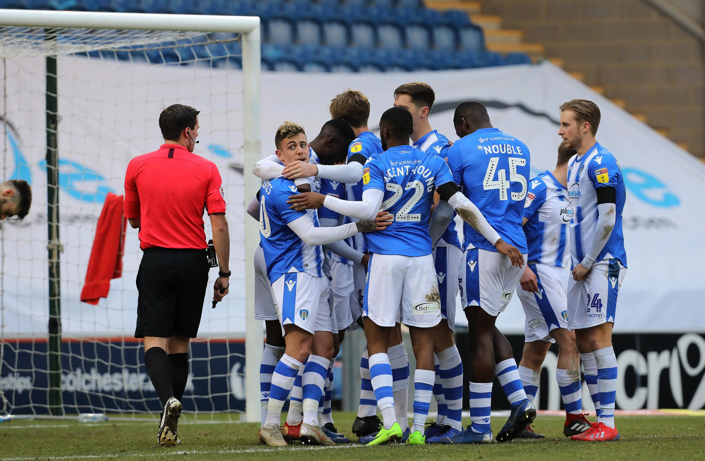 Group hug - Colchester United's players celebrate after Abo Eisa scored their third  goal against Cheltenham Town Picture: STEVE BRADING