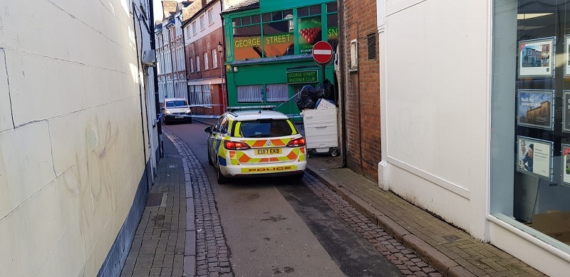Police cordon off road in town centre