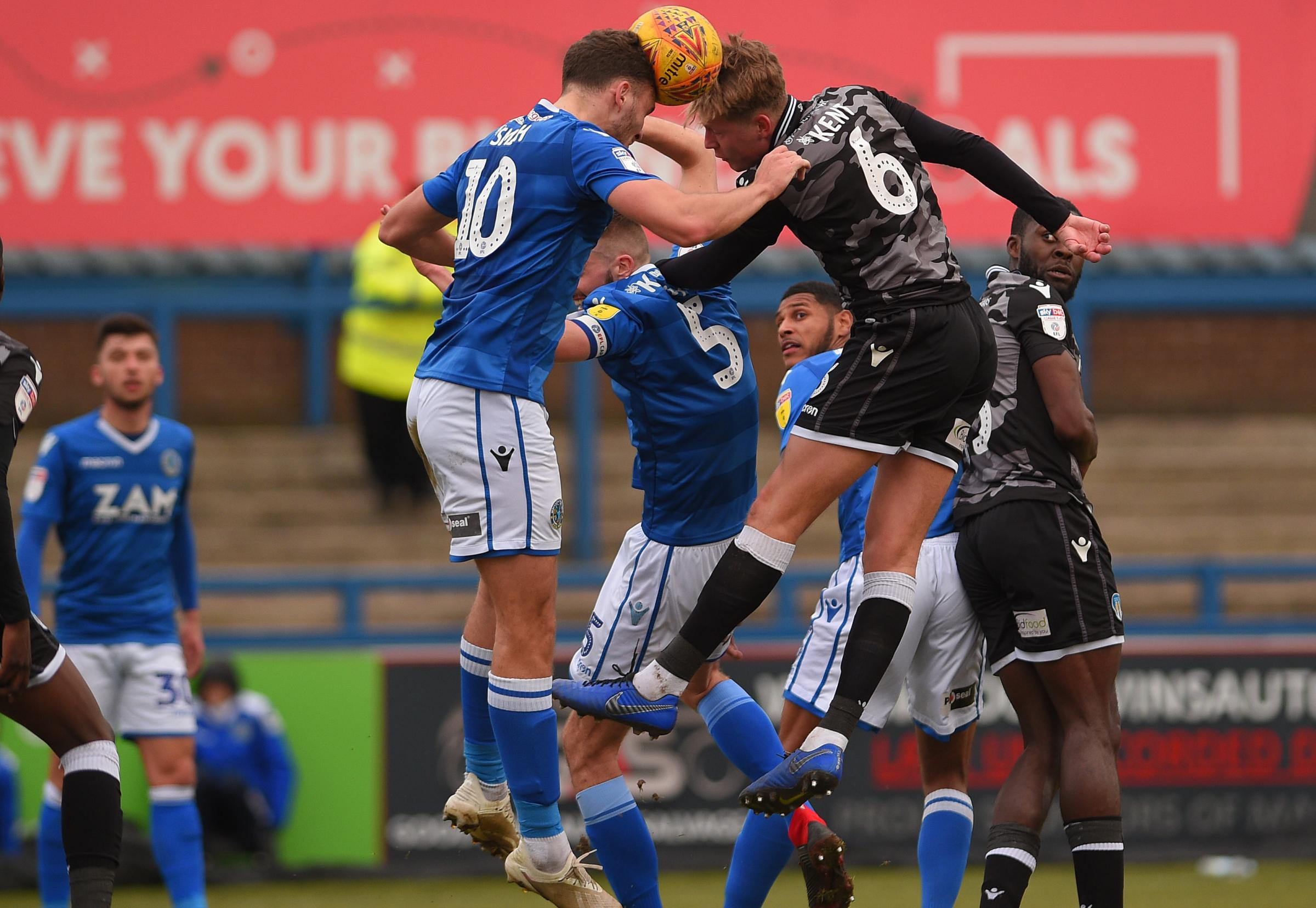Heads up - Colchester United defender Frankie Kent battles at a corner at Macclesfield Town Picture: PAGEPIX