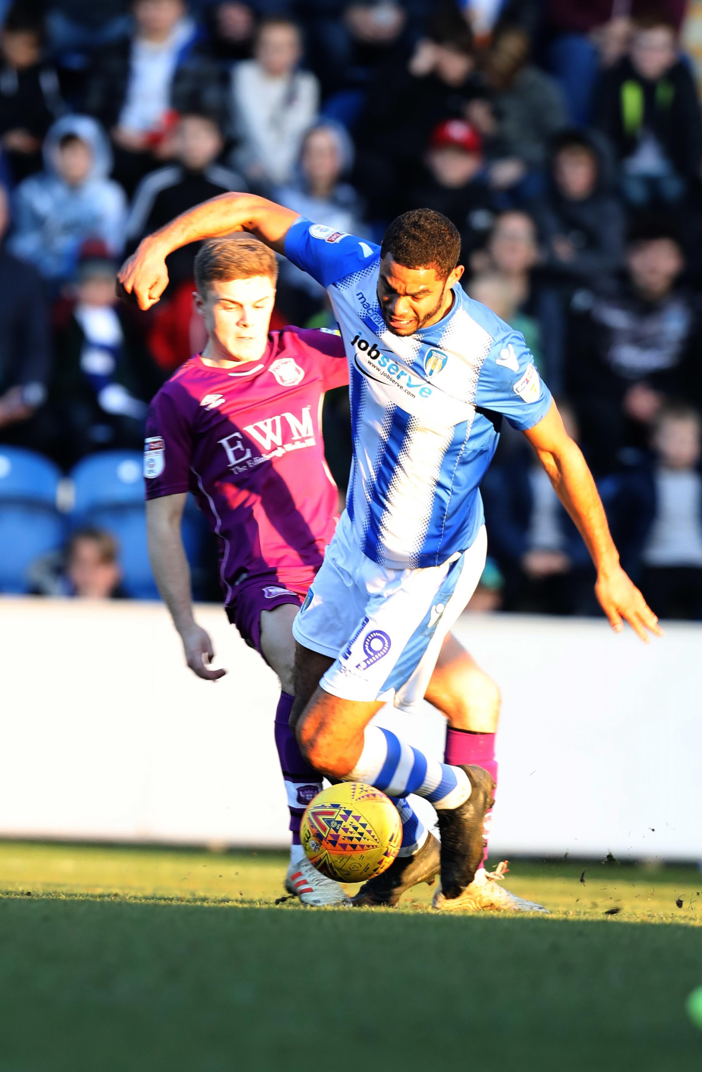 Tussle - Mikael Mandron battles for possession against Carlisle United Picture: STEVE BRADING