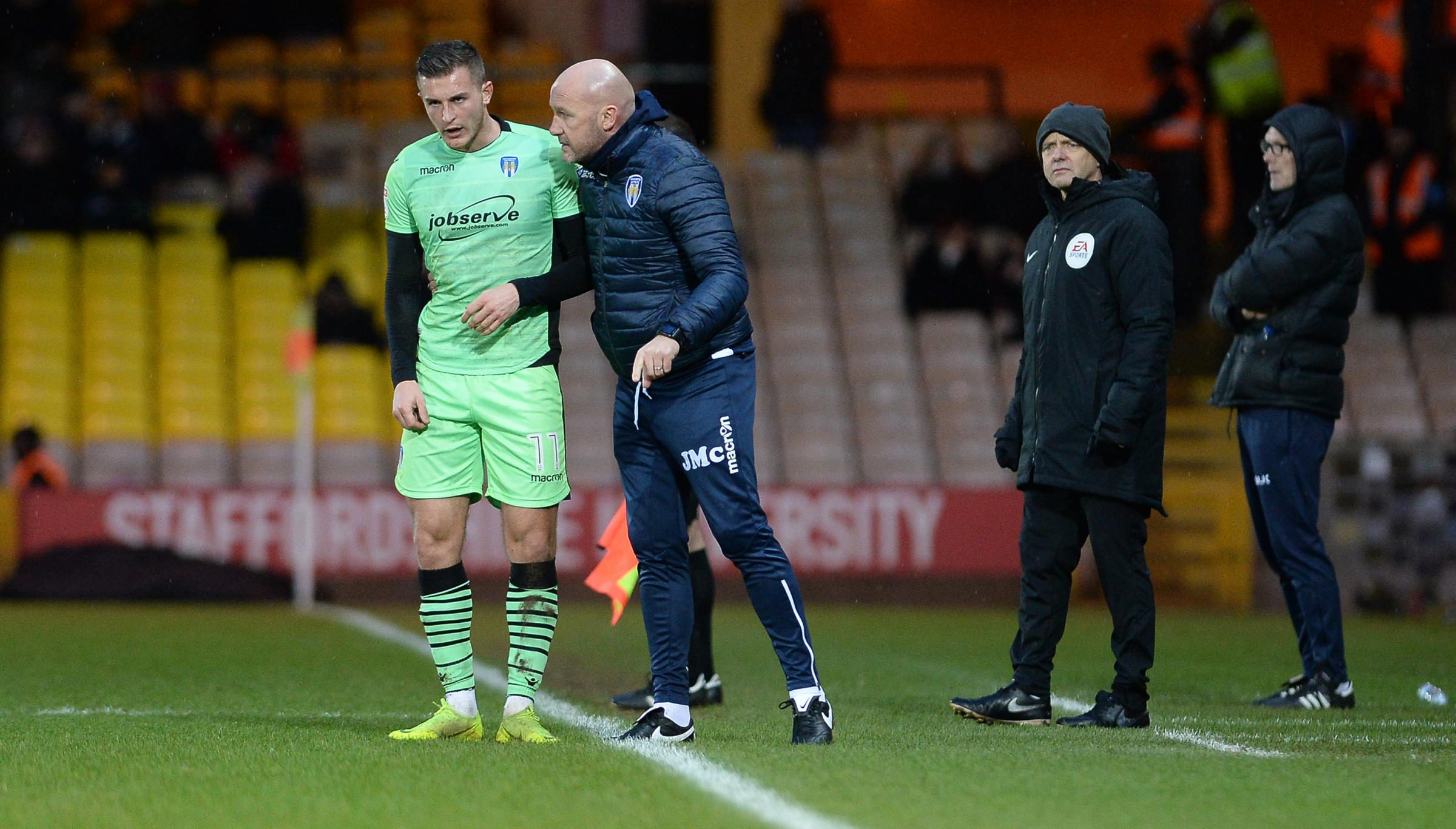 Guidance - Brennan Dickenson gets some advice from Colchester United boss John McGreal Picture: RICHARD BLAXALL