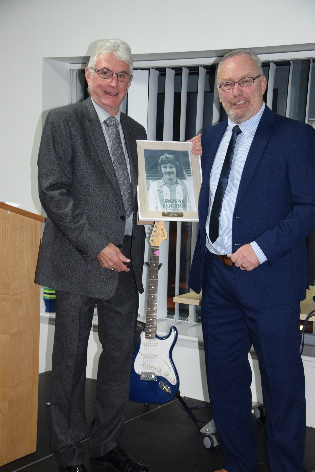 Painting a picture - former Colchester United winger Ian Allinson (right) with Former Players Association chairman Barrie Smith following his induction into the club's Hall of Fame Picture: WWW.CU-FC.COM
