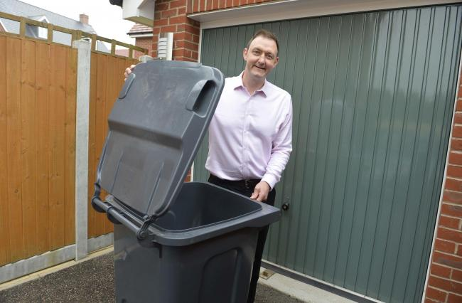 Colchester Cllr Martin Goss with his wheelie bin..