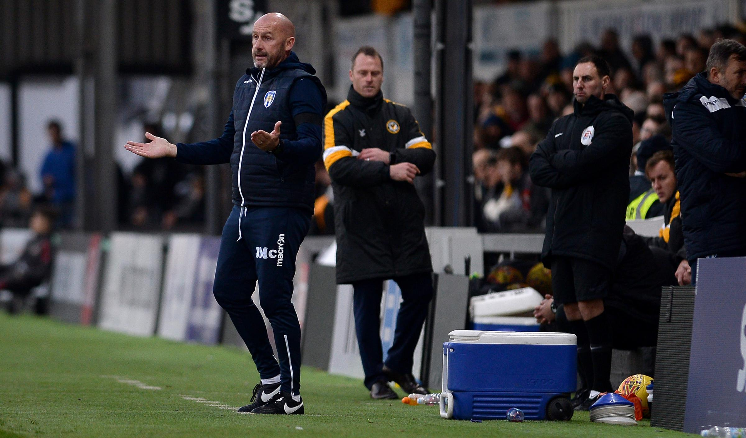 Friendly rivalry - Colchester United boss John McGreal with his Newport County counterpart Michael Flynn in the background during the U's 2-0 loss at Rodney Parade, last November Picture: PAGEPIX