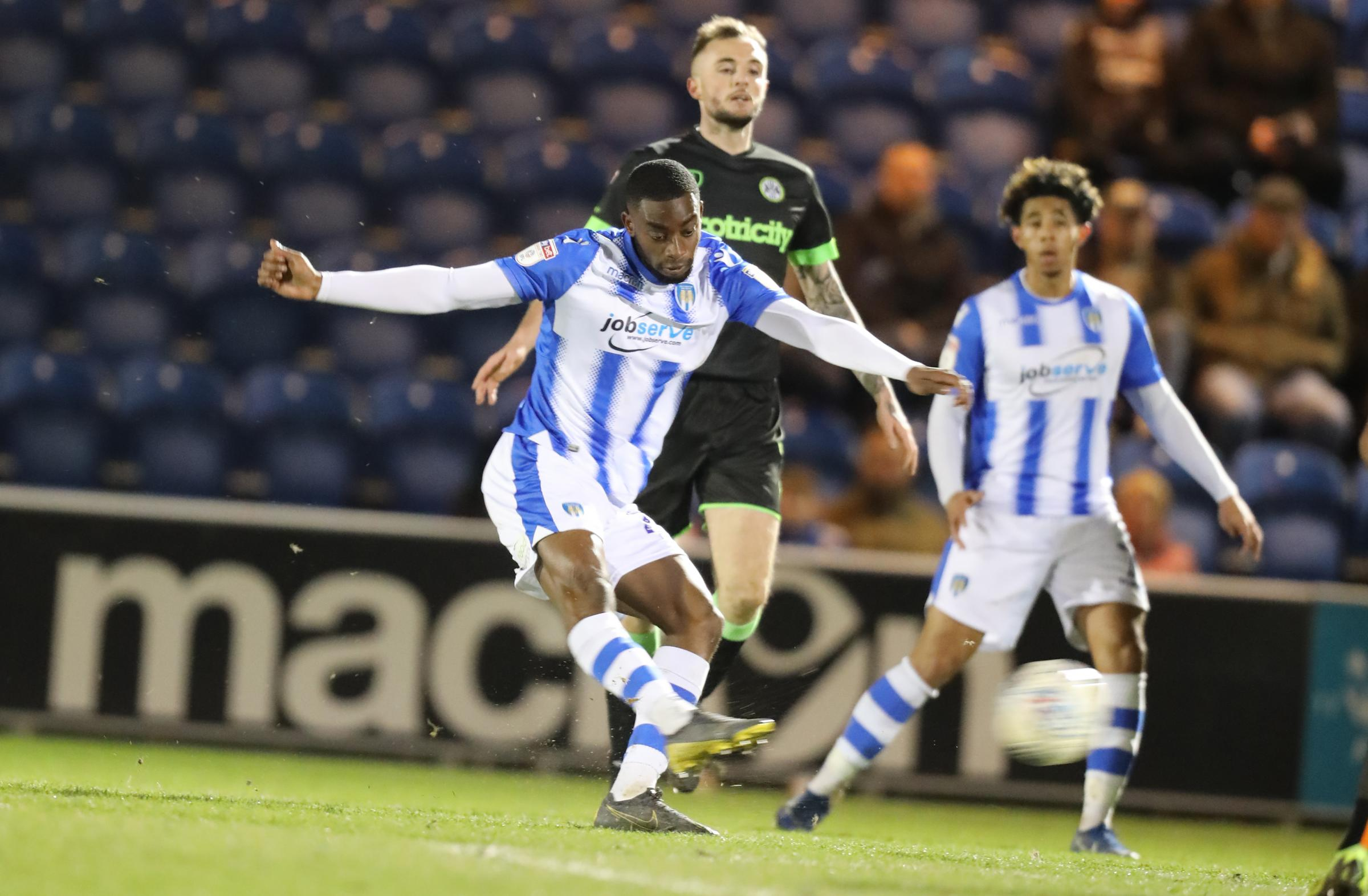 Trying his luck - Colchester United left-back Kane Vincent-Young tries a shot against Forest Green Rovers Picture: STEVE BRADING