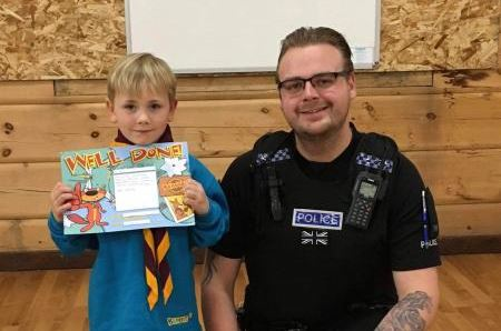 Kaiden being presented with his certificate