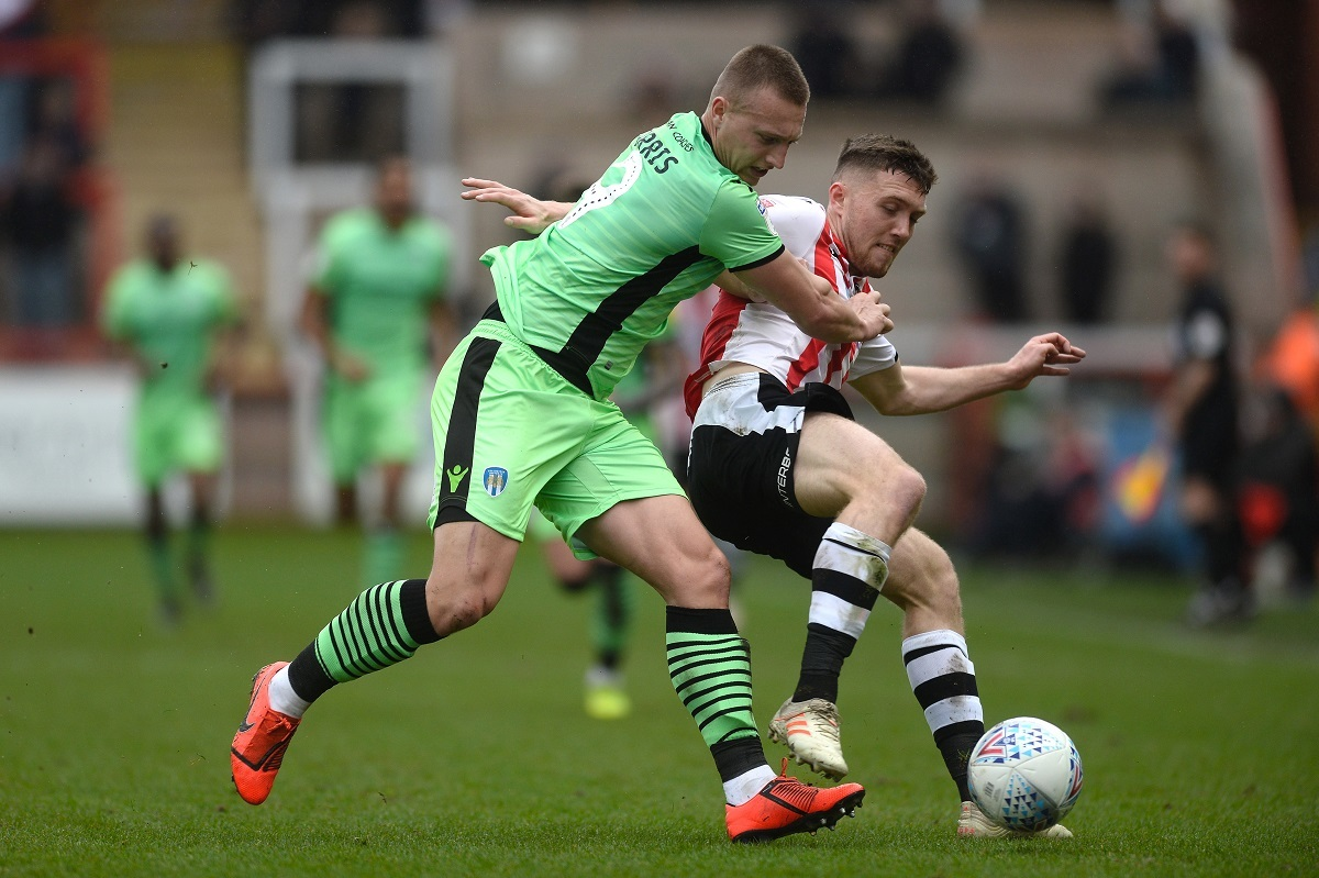 Battle - Luke Norris of Colchester United does battle with Dara O'Shea of Exeter City Picture: RICHARD BLAXALL