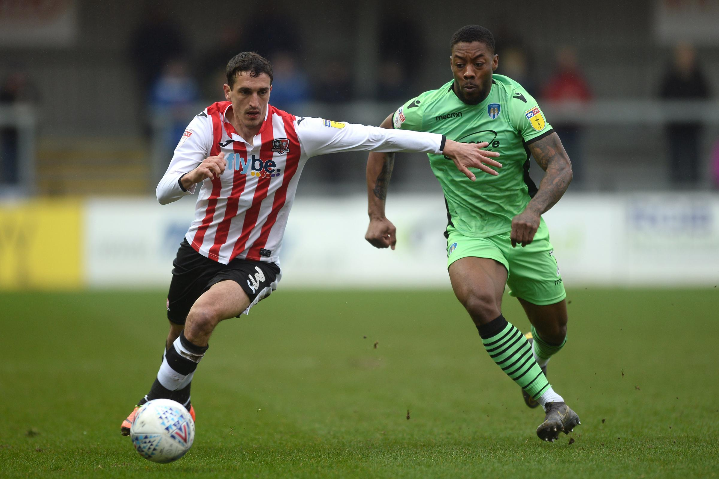 Race for the ball - Colchester United's Ryan Jackson looks to get past Craig Woodman of Exeter City during the U's 3-0 loss Picture: RICHARD BLAXALL