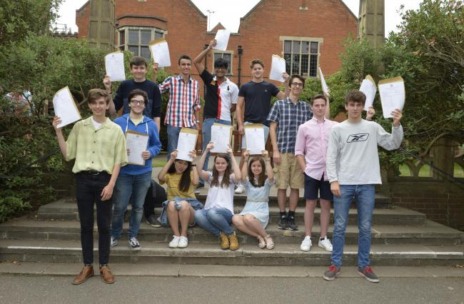 Colchester Grammar School. A level Results day.High flyers celebrate in (an attempt at ) an A shape.