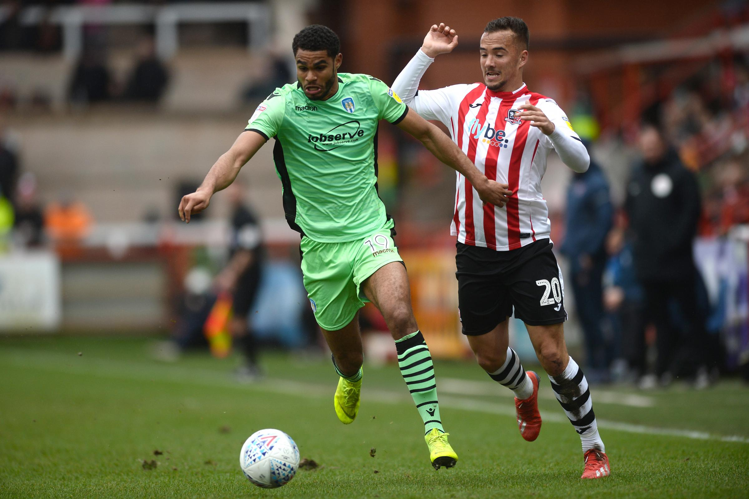 Mikael Mandron of Colchester United looks to get past Kane Wilson of Exeter City - Exeter City vs. Colchester United - Sky Bet League Two - St James Park, Exeter - 15/03/2019 - Photo by: Richard Blaxall.