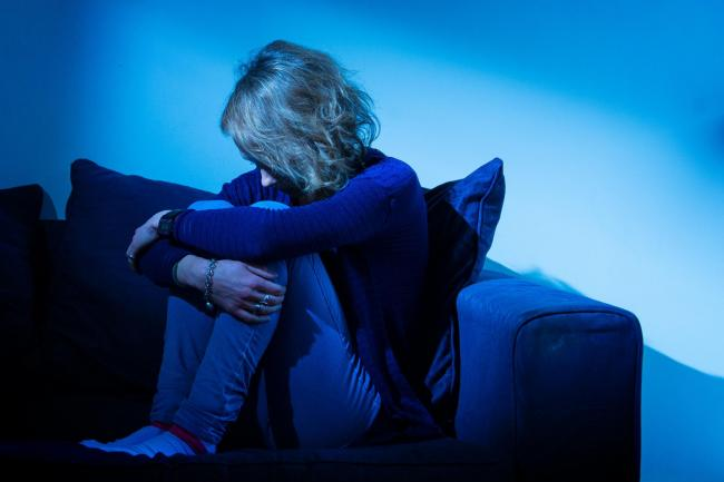 Embargoed to 0001 Wednesday January 02..PICTURE POSED BY MODEL File photo of a woman showing signs of depression. Young people feel more lonely than those in later life, often revealing they feel they have no-one to turn to, according to a new report by t