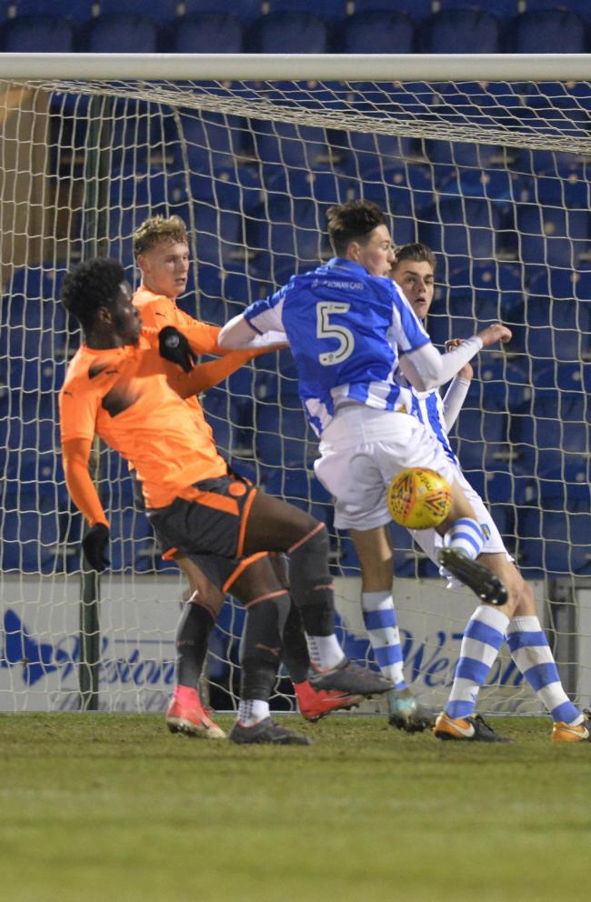 Heads up - Colchester United youngster Billy Cracknell played his part in the U's under-18s win over Birmingham City Picture: STEVE BRADING
