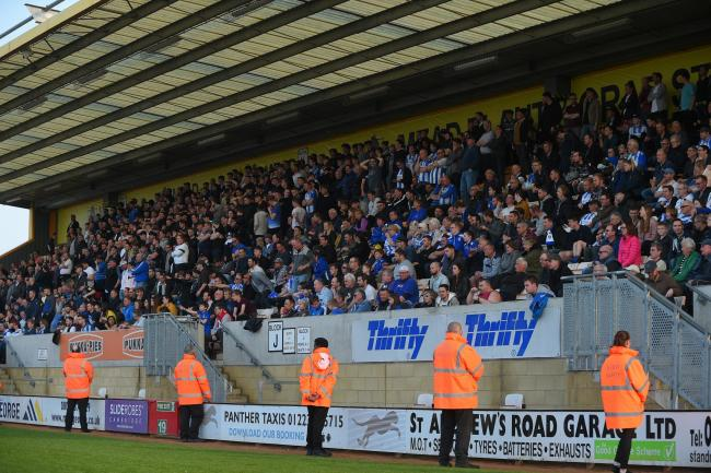 Backing - the massive travelling Colchester United support at Cambridge United Picture Pagepix.