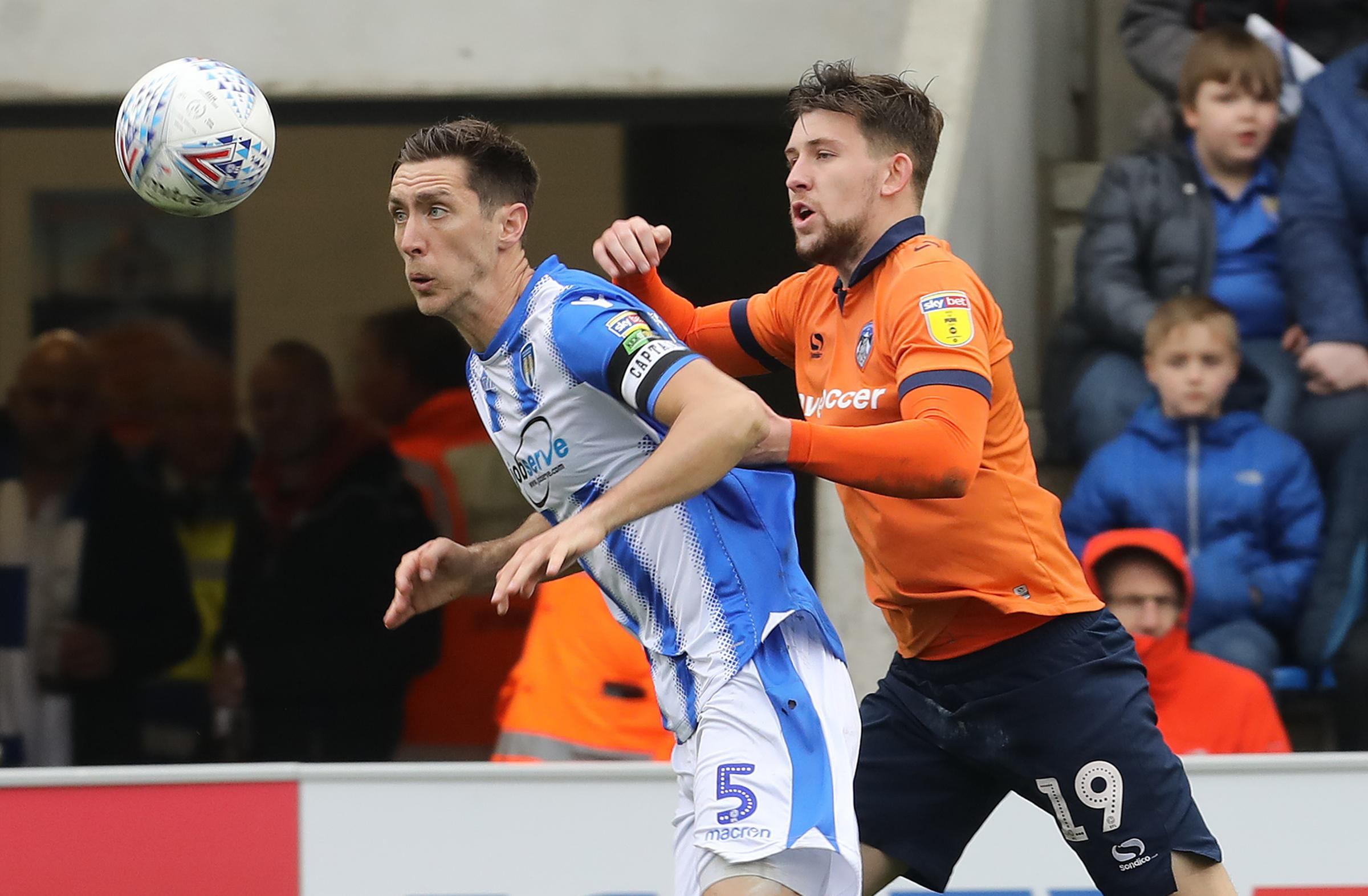 Heads up - Colchester United captain Luke Prosser tussles with Oldham Athletic scorer Callum Lang during the U's 2-0 defeat Picture: STEVE BRADING