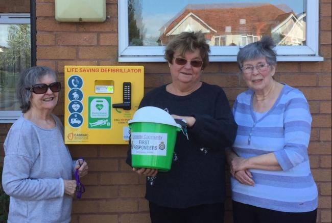 Life saver - councillor Lyn Barton helped pay for Shrub End's second defbrillator at Walnut Tree House and is pictured with residents Maggie Griffin and Jackie Wilby.