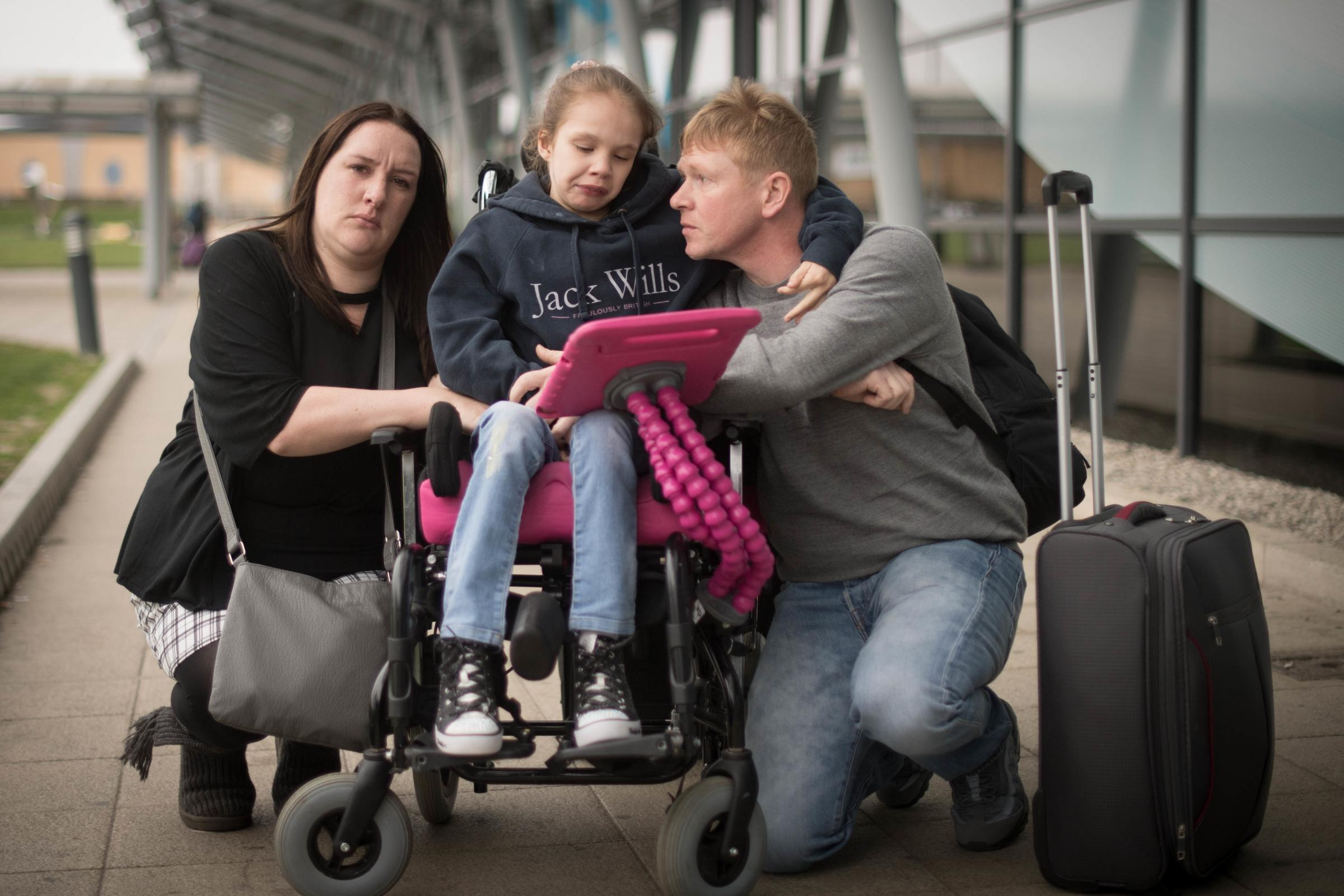 Emma Appleby (left), Lee Moore and their daughter Teagan. The mother of the severely epileptic child has said she is