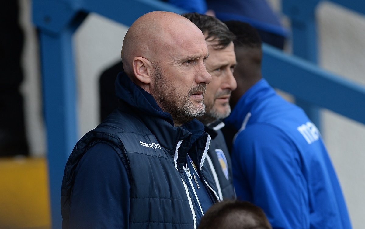 Watching brief - Colchester United boss John McGreal and assistant manager Steve Ball at Bury Picture: PAGEPIX