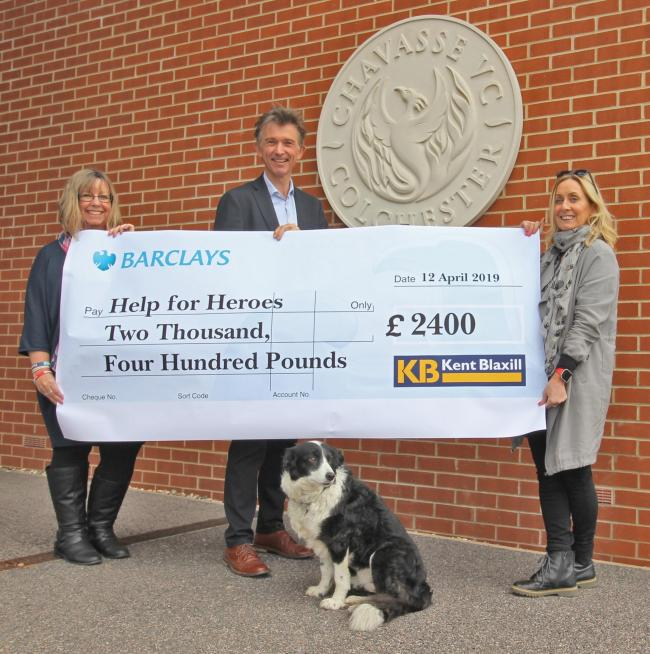 Fundraising - managing director Simon Blaxill hands over a cheque to Help for Heroes following a year of fundraising by Kent Blaxill