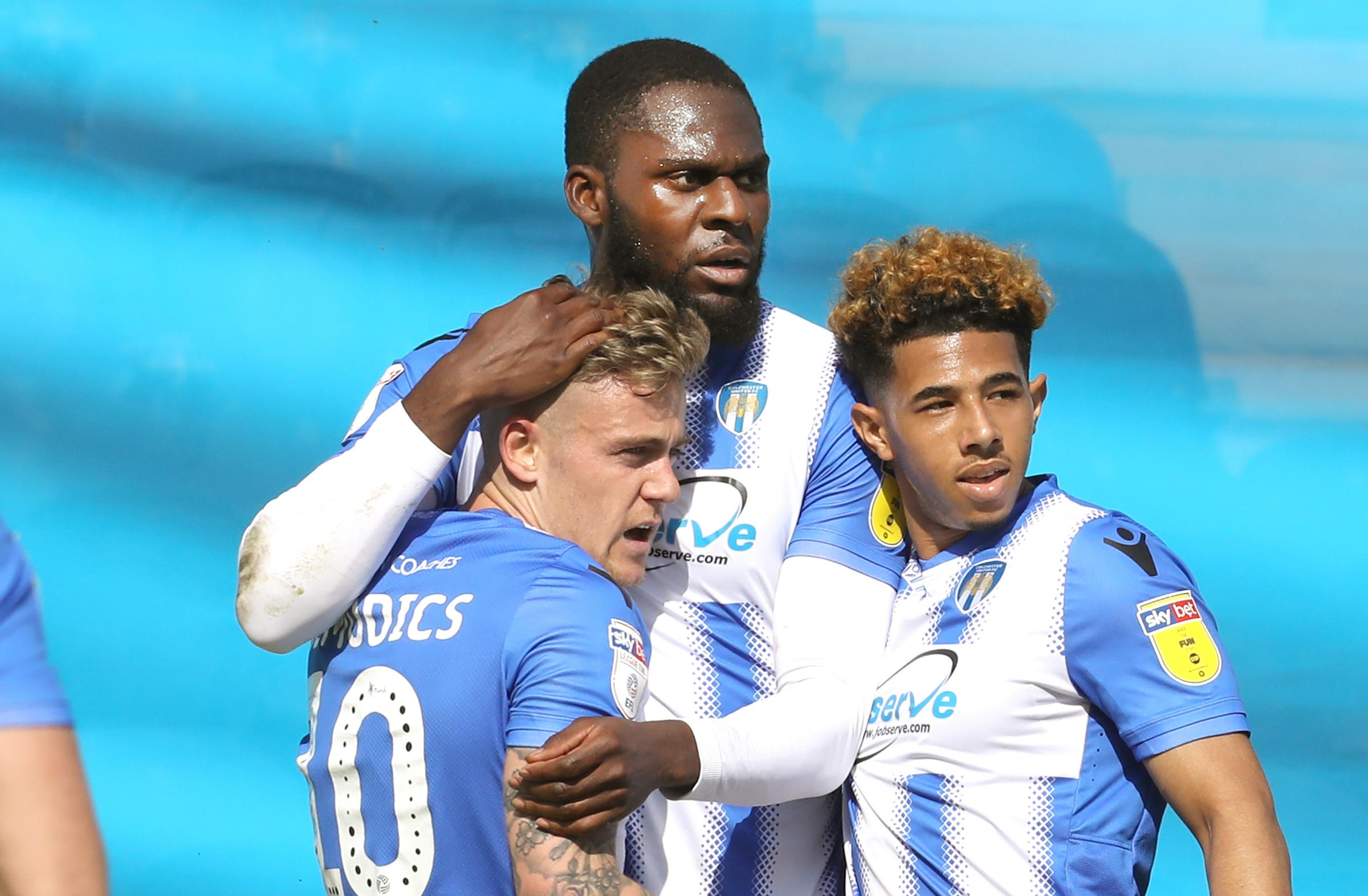 Team spirit - Frank Nouble (centre) celebrates his winning goal with Colchester United team-mates Sammie Szmodics (left) and Courtney Senior Picture: STEVE BRADING