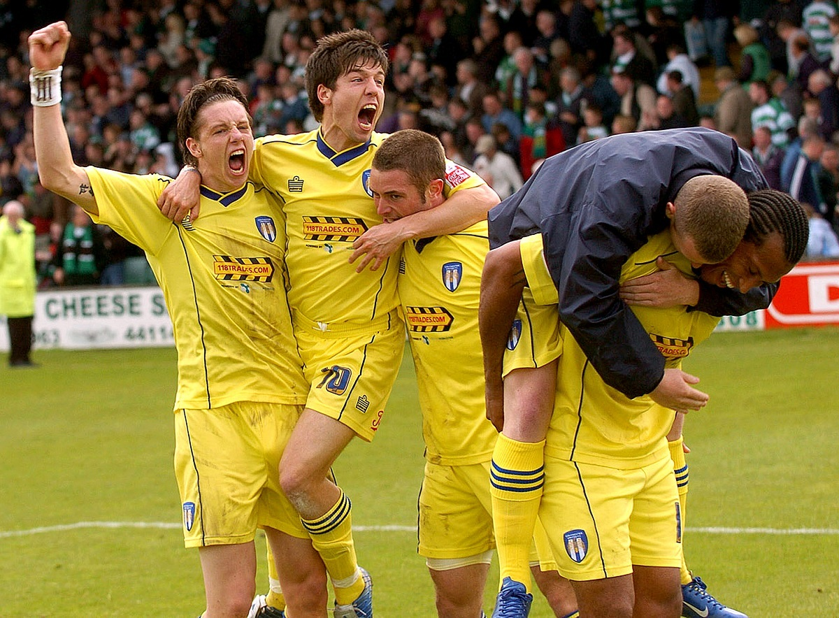 All smiles - Colchester United's players celebrate at Huish Park after drawing 0-0 at Yeovil Town to clinch promotion to the Championship, in 2006 Picture: PAGEPIX