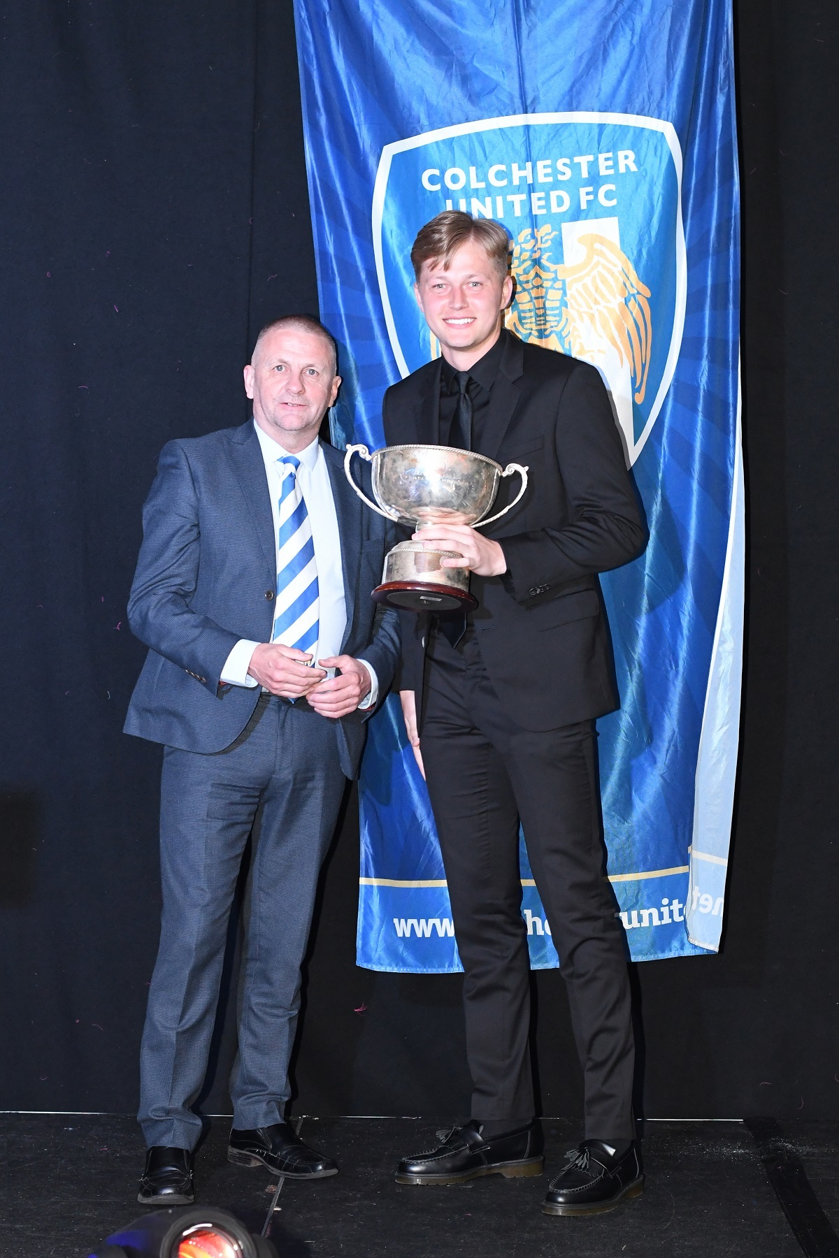 Trophy time - Frankie Kent receives his Player of the Year trophy from chairman Robbie Cowling at Colchester United's End of Season Awards Dinner Picture: JO ADAMS