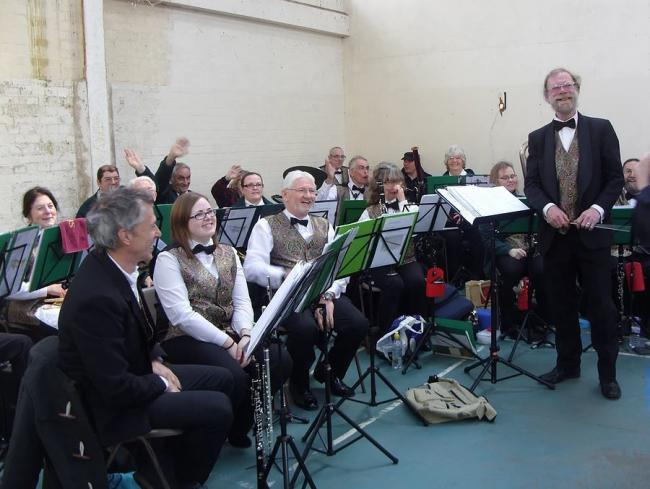 Rewarding - Colne Endeavour's conductor Robert Johnstone with band members