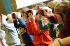 Space - Holmwood House nursery children use virtual reality to see planets