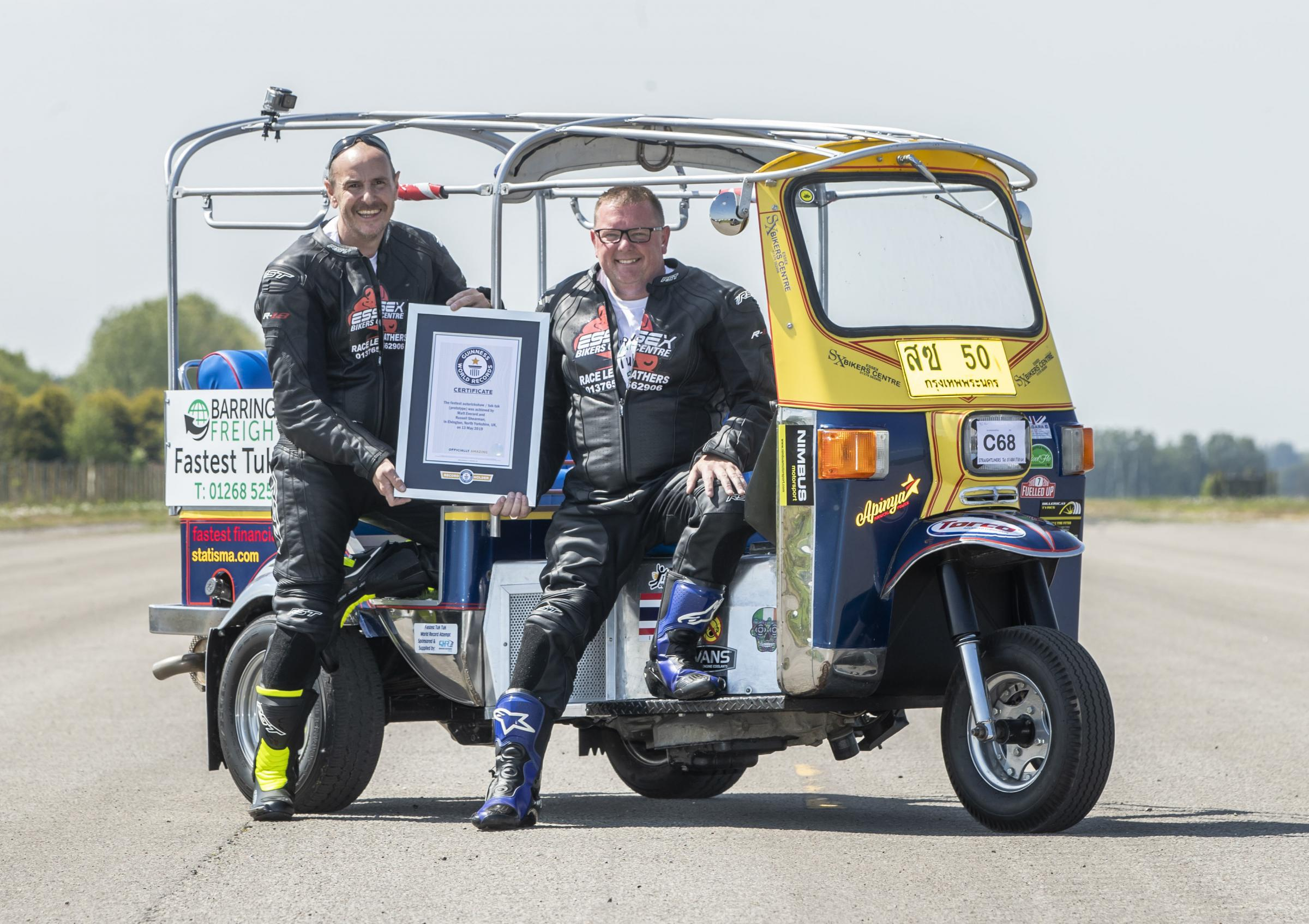 'Over the moon' - Matt Everard (right) and passenger Russell Shearman celebrate their Guinness World Record. Image: Danny Lawson/PA Wire