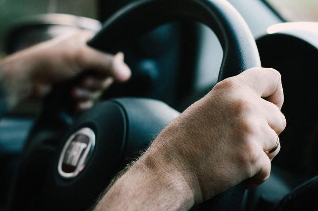 A stock image of someone driving