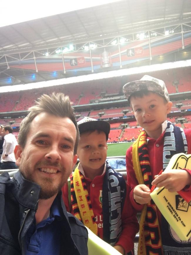 Ambition - Dan Humphries with George, six, and Liam, eight, ahead of the FA Cup final after they were given tickets by Emirates