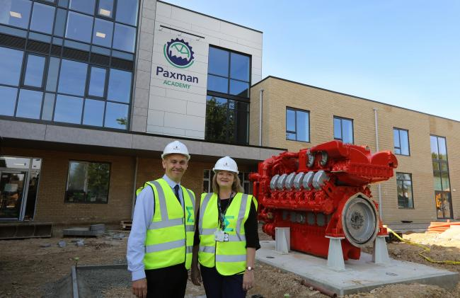 Tour of the new Paxman Academy..Head Carolanne Moffat with her seputy Nick Mussett outside the main entrance with engine outside.