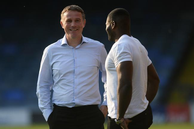 Catching up - former Colchester United manager Phil Parkinson chats to George Elokobi prior to the charity match against Southend United Picture: RICHARD BLAXALL