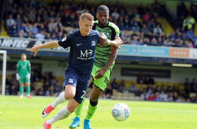 On the move - Joel Grant (green shirt), pictured tussling for possession with Southend United's Jason Demetriou, has been linked with a move to Colchester United Picture: LUAN MARSHALL